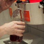 Filling up a growler with tea