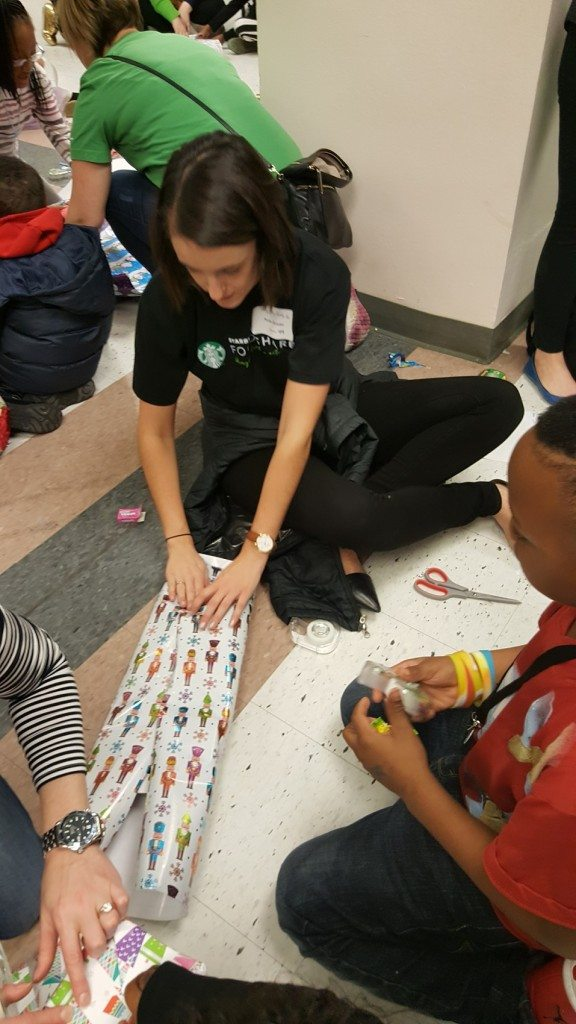 1 - 1 - 20161219_132428 starbucks volunteers helping kids wrap presents