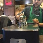 IMG_00441 Sean making a Clover - 2017 Jan 01 - East Olive Way Starbucks